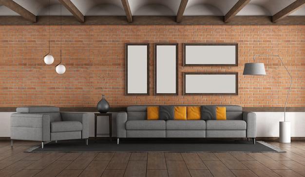 벽돌 벽 .gray 소파와 안락 의자 및 Voulted 천장이있는 거실 프리미엄 사진