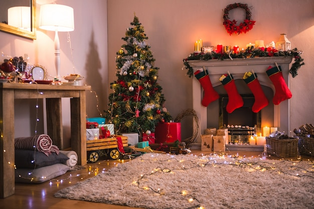 Living room with fireplace and christmas tree Free Photo