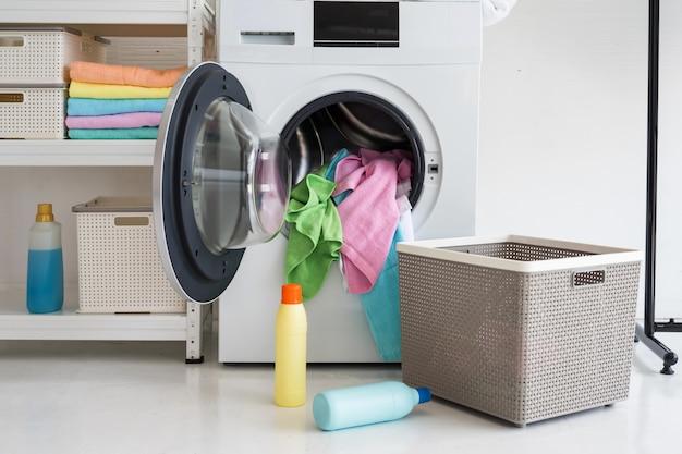 Load laundry in the washing machine Premium Photo