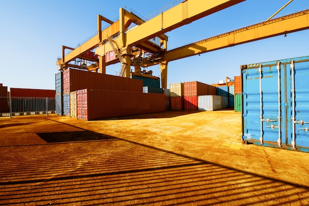 Loading and unloading of containers in the port on a bright sunny day Premium Photo