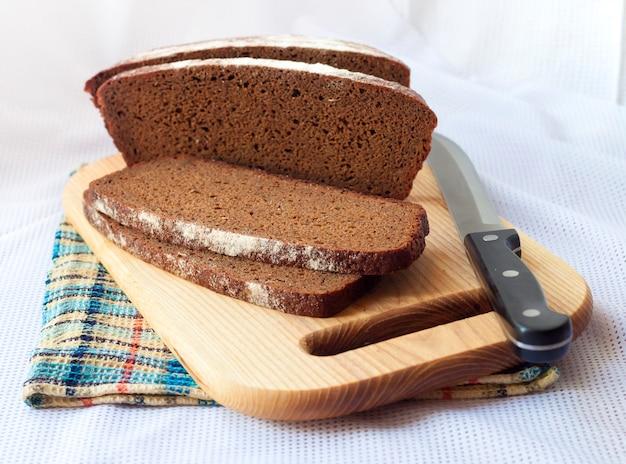 Loaf of wholegrain bread cut on slices Premium Photo