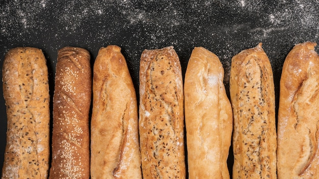 Loaves of bread on black background Free Photo