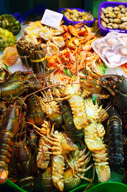 Lobster and other sea food on spanish market Free Photo
