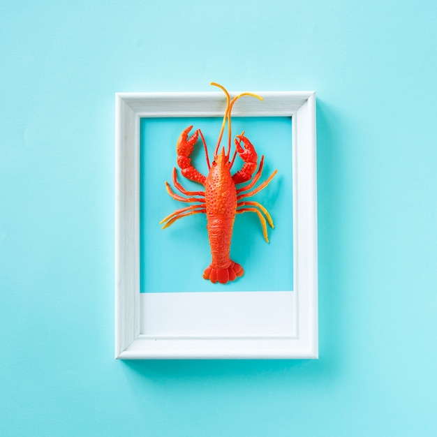 Lobster seafood toy on a frame Free Photo