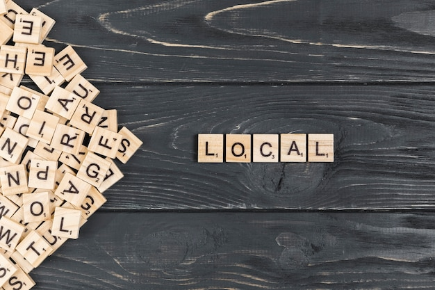 Local word on wooden background Free Photo