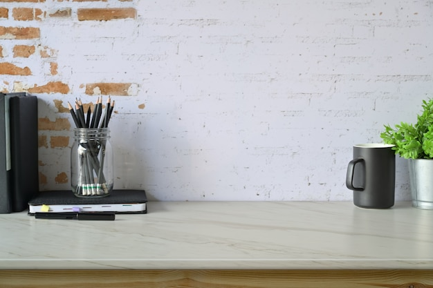 Loft contemporary workspace with home office supplies and copy space. Premium Photo