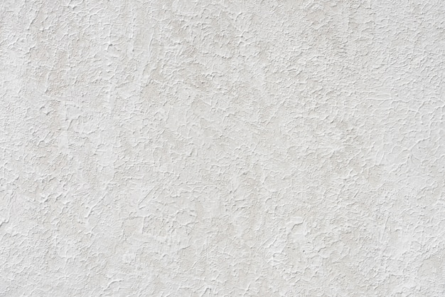 Loft-style plaster walls, gray, white, empty space used as wallpaper. Premium Photo