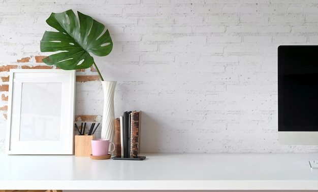 Loft workspace with mockup poster and copy space Premium Photo