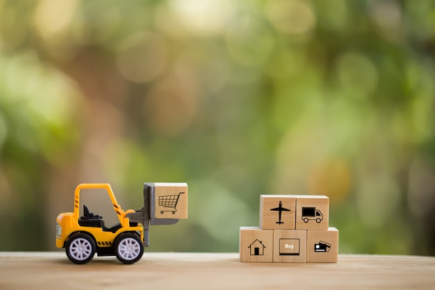 Logistic network distribution and cargo freight concept: mini fork-lift truck moves a pallet with wo