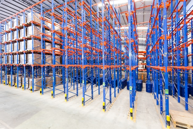 Logistic, storage, shipment, industry and manufacturing concept - storing at warehouse shelves Premium Photo
