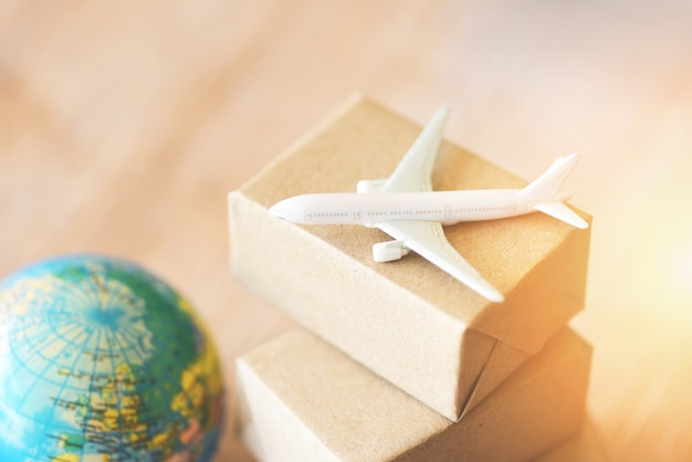 Logistics transport import export shipping air courier cargo plane boxes packaging Premium Photo