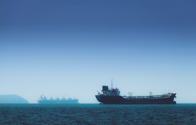 Logistics and transportation of international container cargo ship in the ocean Premium Photo