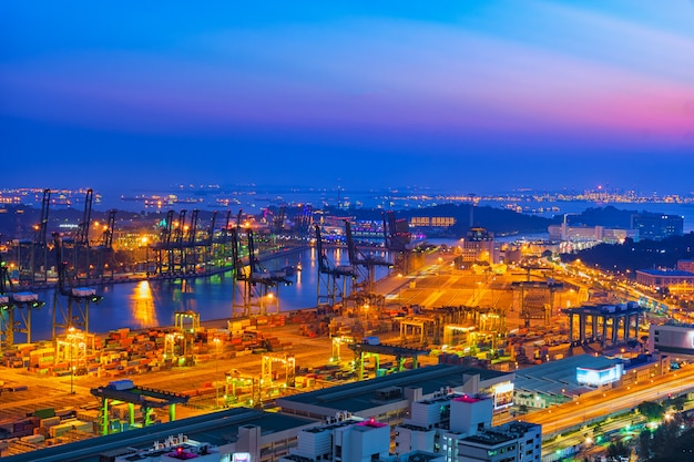 Logistics and transportation shipyard at twilight time. Premium Photo