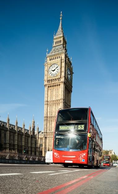 London bus in front of big ben Premium Photo