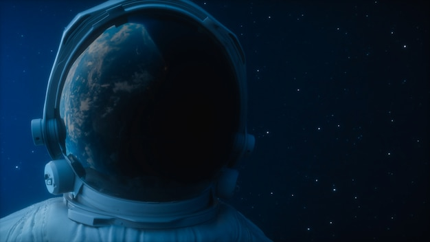 A lone astronaut looks at the planet earth in orbit in outer space Premium Photo
