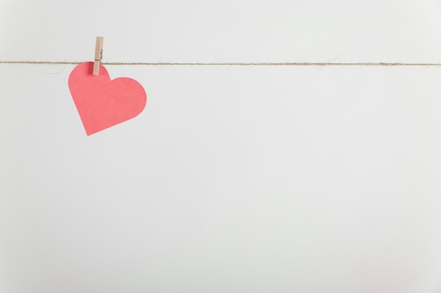 Lone paper heart hanging on rope Free Photo