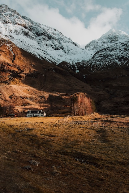 Lonely house between mountains Free Photo