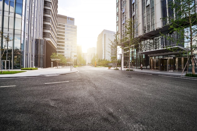 Lonely road with modern buildings Free Photo