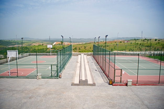 Lonely tennis and basketball court Free Photo