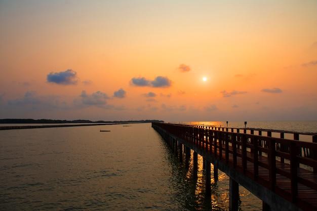 Long bridge at sea view on morning seascape sunrise background Premium Photo
