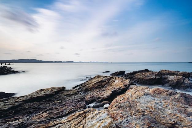 Long exposure rock and coast at sea of thailand Free Photo