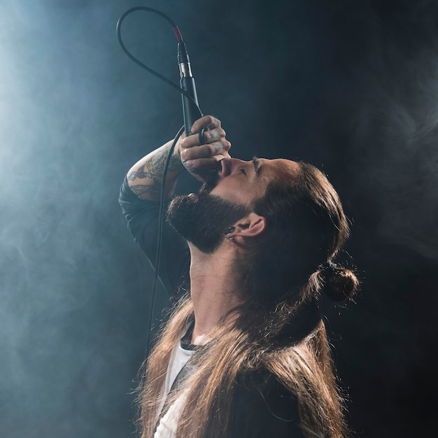 Long hair artist singing on stage Free Photo