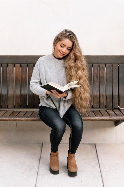 Long hair woman reading a book Free Photo