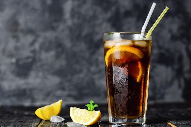 Long island cocktail on dark surface Premium Photo