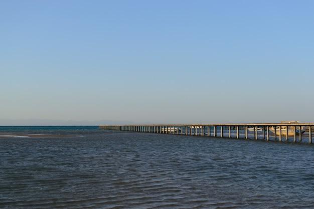 Long pier in the sea evening Premium Photo