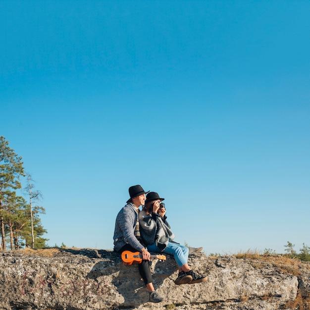 Long shot adorable couple outdoors Free Photo