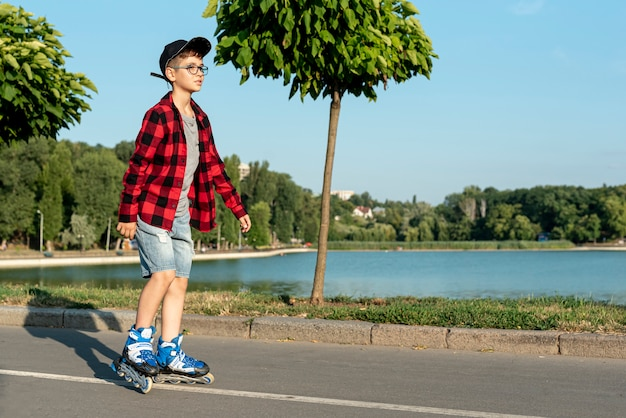 Long shot of boy with roller blades Free Photo