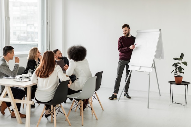 Long shot of business people in meeting Free Photo