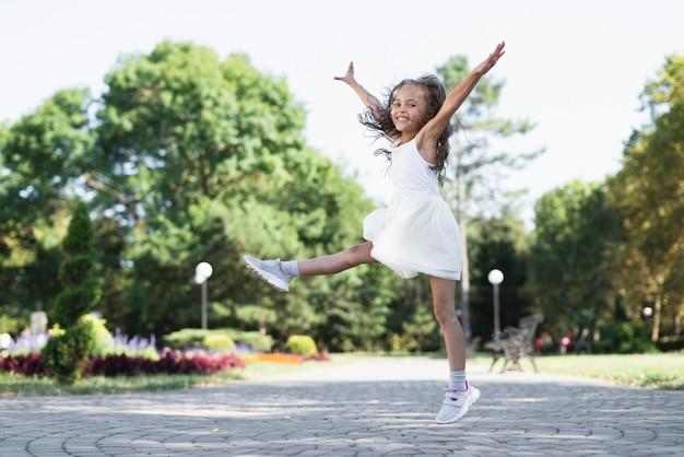 Long shot of cute girl in park Free Photo