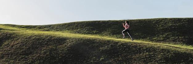 Long shot female running outdoor Premium Photo