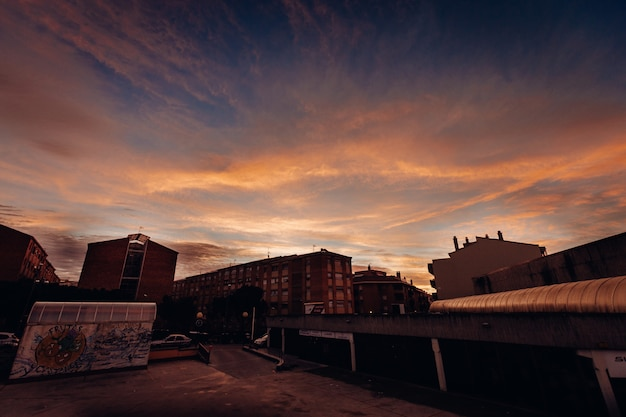 Long shot of numerous buildings and houses in the city during sunset Free Photo
