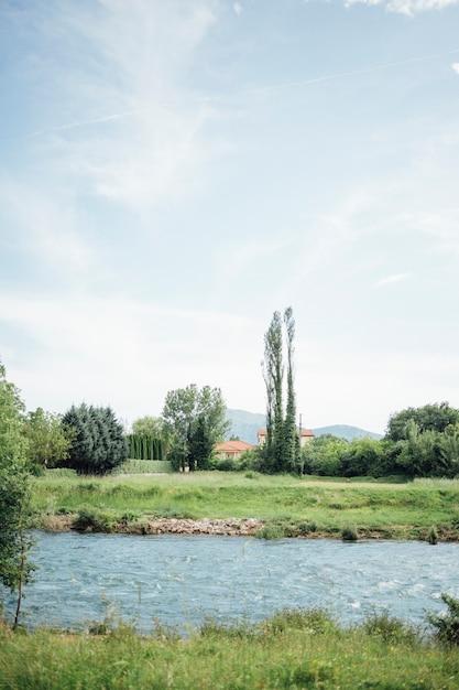Long shot river crossing through farmland Free Photo
