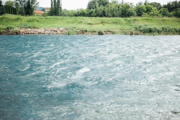 Long shot of river in farmland Free Photo