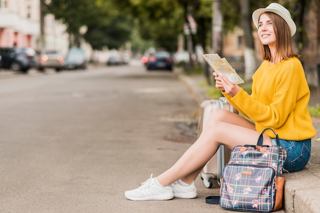 Long shot of solo travelling woman Free Photo