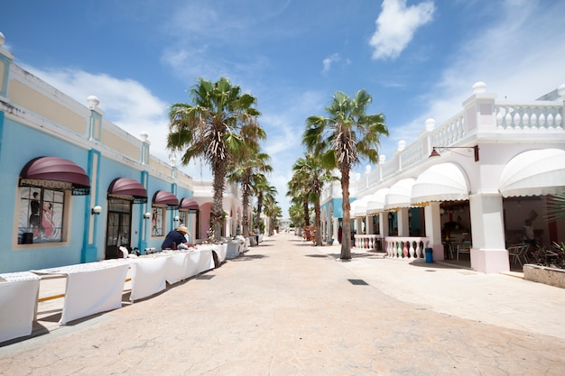 Long shot of street in tropical tourist resort Free Photo