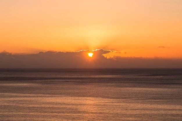 Long shot of sun set at the seaside Free Photo