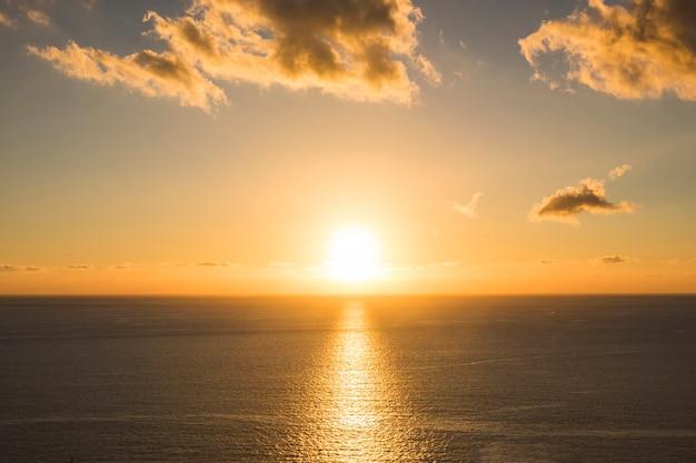 Long shot sunset at the beach Free Photo