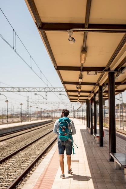 Long shot traveler in train station Free Photo