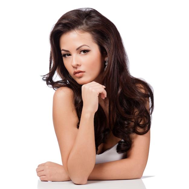 Long straight hair. beautiful brunette girl isolated on white Premium Photo