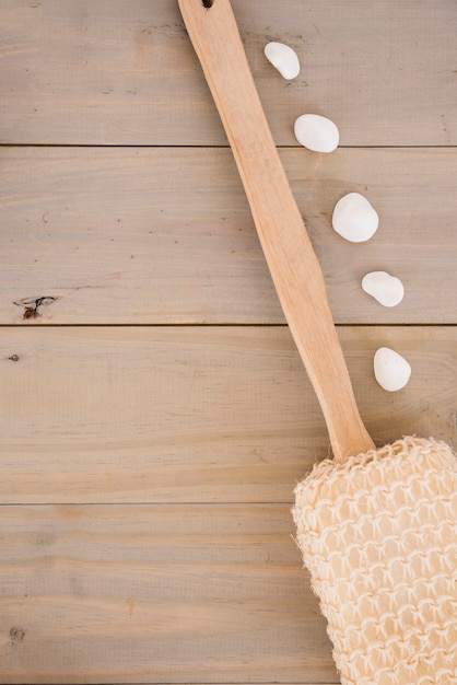 Loofah with long wooden handle and pebble Free Photo