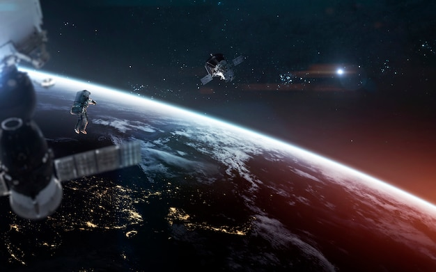 Look on our planet from orbit and astronauts at the spacewalk. Premium Photo
