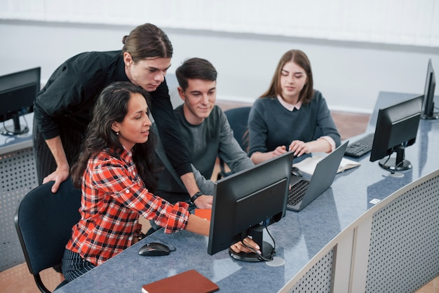 Look at this. group of young people in casual clothes working in the modern office Free Photo