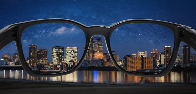 Looking city at night with starry sky through glasses Premium Photo