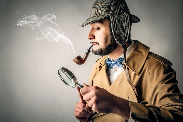 Looking into a magnifying glass Premium Photo