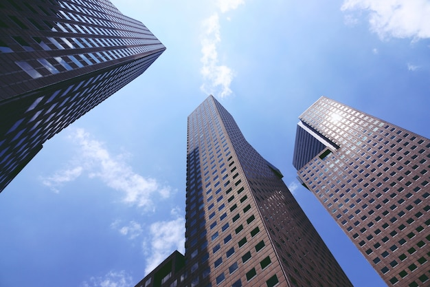 Looking up at business buildings at singapore Premium Photo