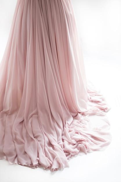 Loop of a wedding dress on a floor. wedding dress hem, studio, light background Premium Photo